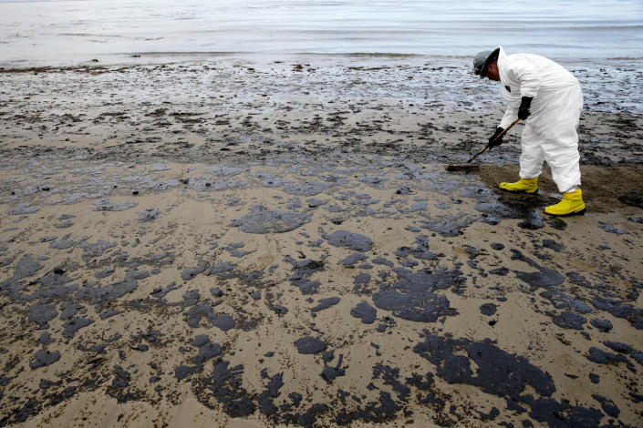 A worker removes oil from the sand at Refugio State Beach in the Santa Barbara Channel, north of Goleta, Calif., as cleanup continued a month after the May 19 oil spill north of Santa Barbara, Calif. (Photo: Jae C. Hong/AP)