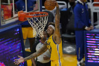 Golden State Warriors forward Kelly Oubre Jr. dunks against the Sacramento Kings during the first half of an NBA basketball game in San Francisco, Monday, Jan. 4, 2021. (AP Photo/Jeff Chiu)