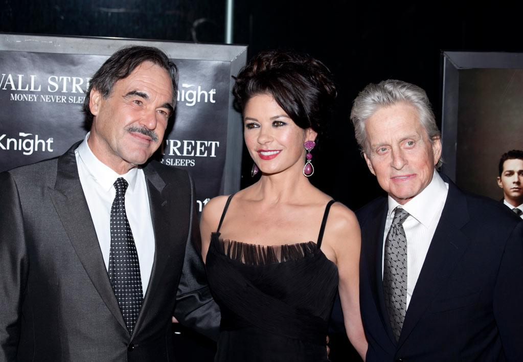 """<a href=""""http://movies.yahoo.com/movie/contributor/1800011649"""">Oliver Stone</a>, <a href=""""http://movies.yahoo.com/movie/contributor/1800019539"""">Catherine Zeta-Jones</a> and <a href=""""http://movies.yahoo.com/movie/contributor/1800012782"""">Michael Douglas</a> attend the New York City premiere of <a href=""""http://movies.yahoo.com/movie/1810045848/info"""">Wall Street: Money Never Sleeps</a> on September 20, 2010."""