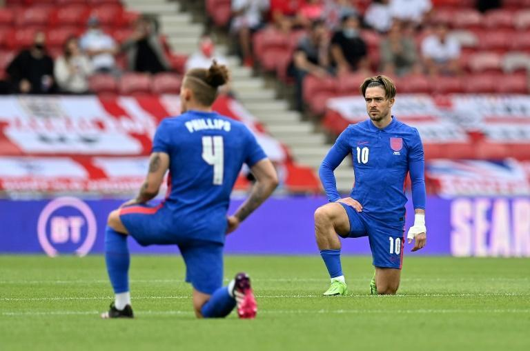 England players take the knee ahead of their match against Romania