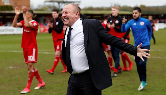 "Soccer Football - League Two - Accrington Stanley v Lincoln City - Wham Stadium, Accrington, Britain - April 28, 2018 Accrington Stanley's manager John Coleman celebrates after winning League Two Action Images/Andrew Boyers EDITORIAL USE ONLY. No use with unauthorized audio, video, data, fixture lists, club/league logos or ""live"" services. Online in-match use limited to 75 images, no video emulation. No use in betting, games or single club/league/player publications. Please contact your account representative for further details."