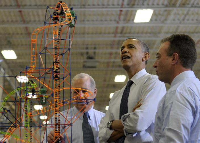 President Barack Obama looks over a rollercoaster with K'NEX Inventor Joel Glickman, left, and Rodon Group President and Chief Executive Officer Michael Araten, right, during a tour of the company in Hatfield, Pa. Friday, Nov. 30, 2012. The visit comes as the White House continues a week of public outreach efforts, while also attempting to negotiate a deal with congressional leaders. The Rodon Group manufactures over 95% of the parts for KíNEX Brands toys. (AP Photo/Susan Walsh)