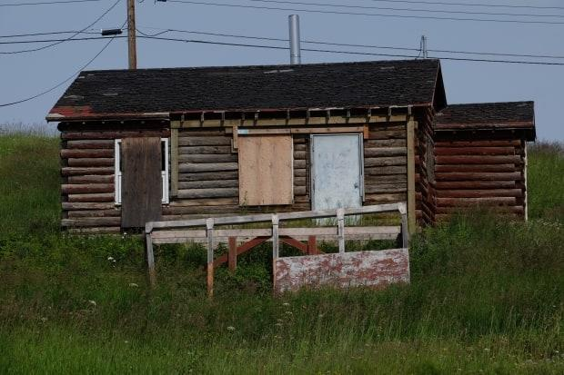 A boarded-up home is shown in July 2018 in Fort Good Hope, N.W.T. The territorial and federal government are creating a working group — which will be including communities — to address the territory's housing crisis. (Alex Brockman/CBC - image credit)