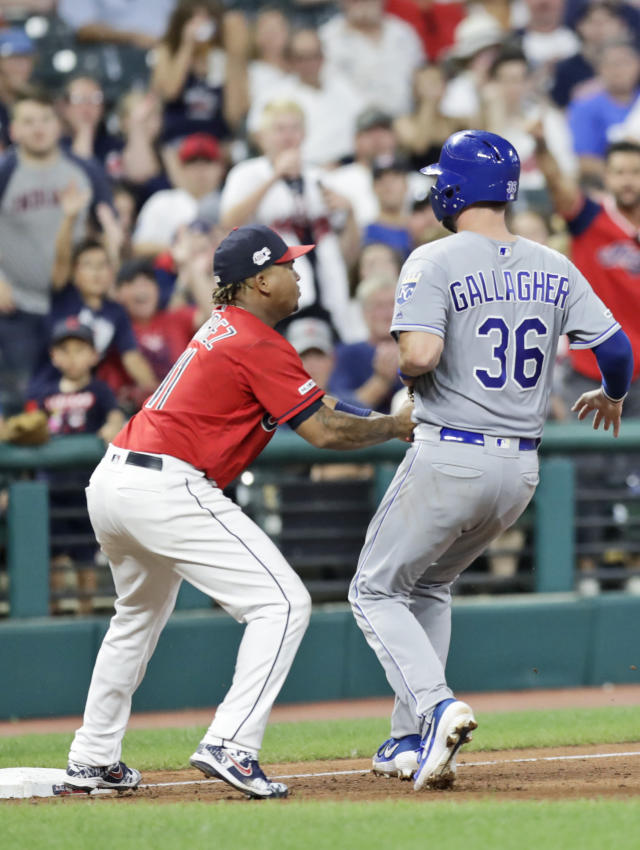 Cleveland Indians' Jose Ramirez, left, tags out Kansas City Royals' Cam Gallagher at third base on a steal in the eighth inning of a baseball game, Saturday, July 20, 2019, in Cleveland. (AP Photo/Tony Dejak)