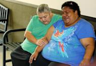 Liz Fleetwood, left, comforts her friend, Rachel Padilla, the sister of 15-year-old murder suspect James Edwards Jr., after finding out bail has been denied for Edwards following a court appearance in Duncan, Okla., Tuesday, Aug. 20, 2013. Chancey Luna, 16, James Edwards Jr., 15, and Michael Jones, 17, are charged in the murder of 22-year-old Australian Christopher Lane, who was on a baseball scholarship at East Central University in Ada, Okla. Lane was in Duncan visiting his girlfriend when he was shot and killed Friday, Aug. 16, 2013. (AP Photo/Sue Ogrocki)
