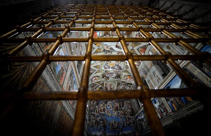 The Sistine Chapel with its new lighting is seen through a fence on October 29, 2014 (AFP Photo/Filippo Monteforte)