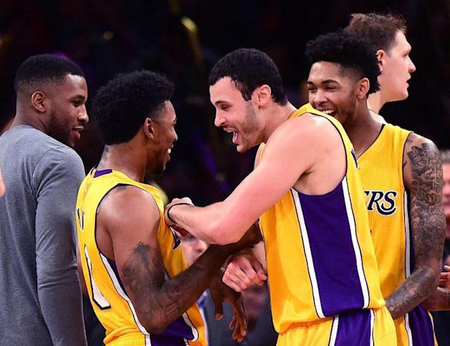 """<a class=""""link rapid-noclick-resp"""" href=""""/nba/players/4294/"""" data-ylk=""""slk:Nick Young"""">Nick Young</a> and his teammates celebrate an improbable winner. (Getty Images)"""