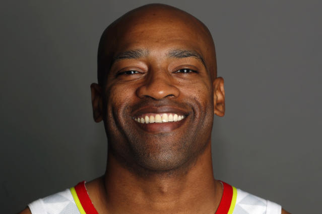 FILE - In this Sept. 30, 2019, file photo, Atlanta Hawks guard Vince Carter (15) is shown during their NBA basketball media day in Atlanta. Carter made his retirement official Thursday, June 25, 2020, announcing on his podcast that his 22-year NBA career has come to an end. The announcement was largely a formality, since the 43-year-old Carter had said many times over the course of this season that this would be his last in the NBA. His 22 seasons are the most in league history, and he became the first NBA player to appear in four different decades.(AP Photo/John Bazemore, File)