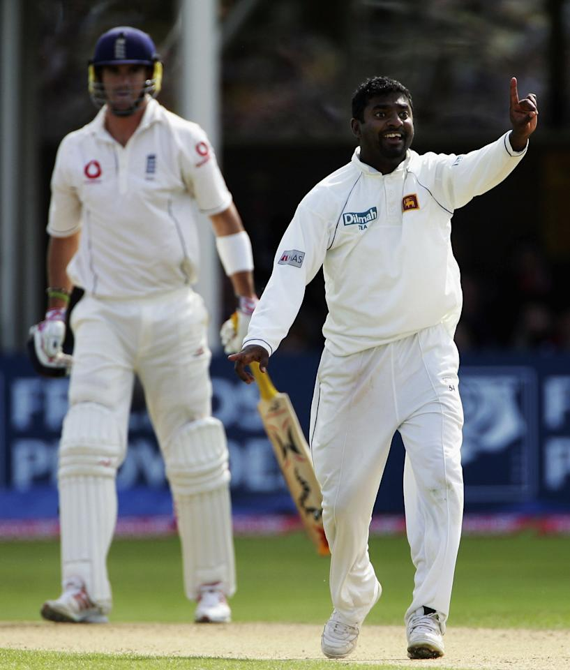 BIRMINGHAM, UNITED KINGDOM - MAY 26:  Muttiah Muralitharan of Sri Lanka claims the wicket of Kevin Pietersen of England during the seocnd day of the second npowerTest Match between England and Sri Lanka at the Edgbaston Cricket Ground on May 26, 2006 in Birmingham, England.  (Photo by Shaun Botterill/Getty Images)