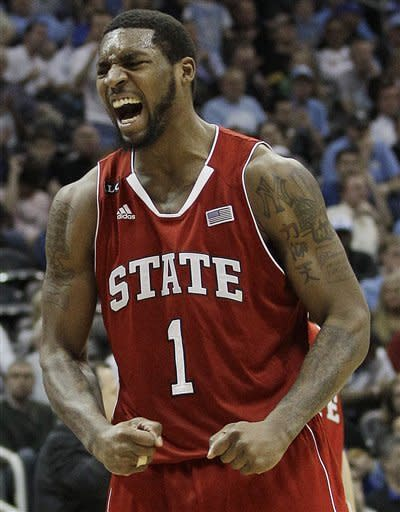 North Carolina State forward Richard Howell (1) reacts after making a basket against North Carolina during the second half of an NCAA college basketball game in the semifinals of the Atlantic Coast Conference tournament, Saturday, March 10, 2012, in Atlanta. (AP Photo/Chuck Burton)