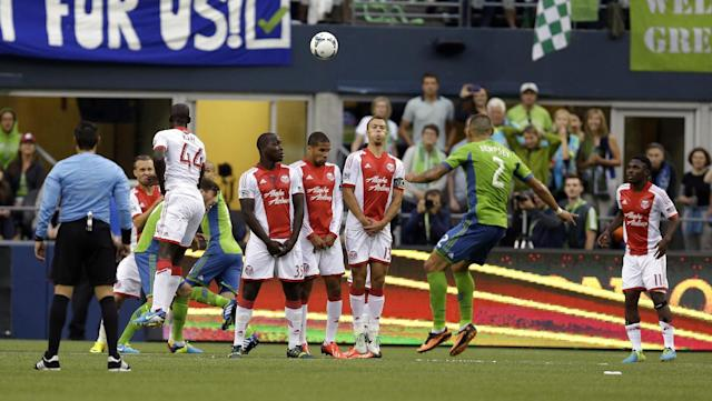 Seattle Sounders' Clint Dempsey (2) faces a wall of Portland Timbers players as he takes a penalty kick in the first half of a MLS soccer match, Sunday, Aug. 25, 2013, in Seattle. (AP Photo/Ted S. Warren)