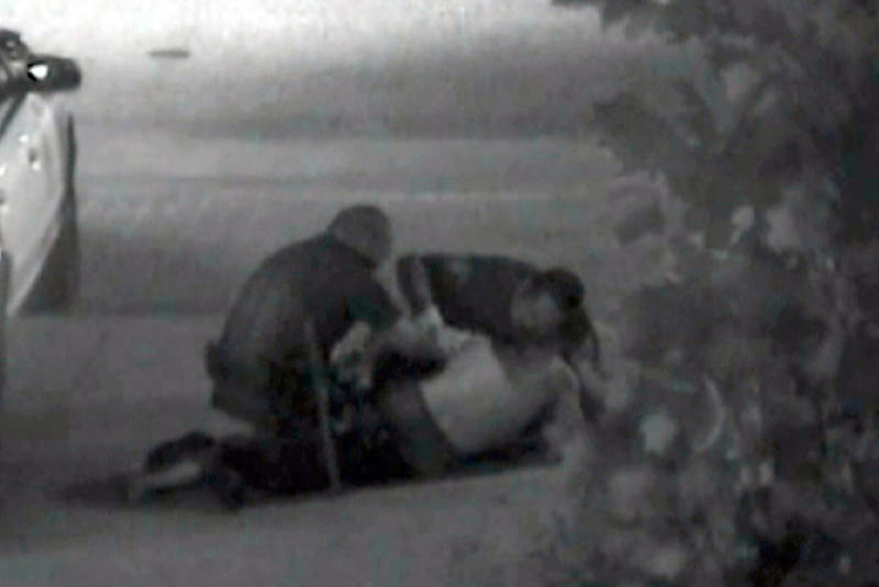 FILE - This July 5, 2011 file still frame from security camera video, released May 7, 2012, by the Orange County District Attorney, shows an altercation between Fullerton police officers and Kelly Thomas at the Fullerton, Calif., bus depot. Thomas died days later. Two officers, Manuel Ramos, and Jay Ciccinelli, are on trial charges related to his death. Closing arguments are scheduled to begin Tuesday, Jan. 7, 2013. (AP Photo/Orange County District Attorney, File)