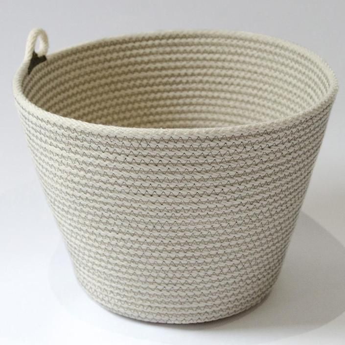 """Never underestimate the storage and decorative power of a well-made basket. Case in point: this earthy, handcrafted South African basket made of locally sourced cotton. $55, 54Kibo. <a href=""""https://54kibo.com/products/coiled-cotton-bowl-medium-grey-stitch?_pos=15&_sid=2b3c9764a&_ss=r"""" rel=""""nofollow noopener"""" target=""""_blank"""" data-ylk=""""slk:Get it now!"""" class=""""link rapid-noclick-resp"""">Get it now!</a>"""