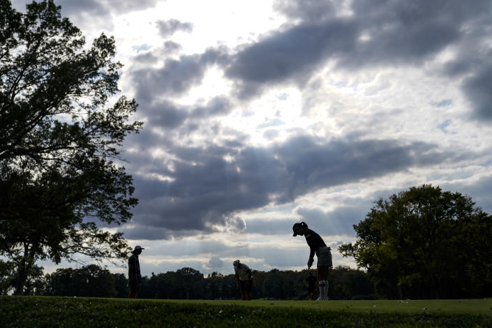 So Yeon Ryu, right, of South Korea, putts on the fourth green in the second round of the Cognizant Founders Cup LPGA golf tournament, Friday, Oct. 8, 2021, in West Caldwell, N.J. (AP Photo/John Minchillo)