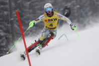 Norway's Sebastian Foss Solevaag speeds down the course during an alpine ski, men's World Cup slalom in Flachau, Austria, Saturday, Jan. 16, 2021. (AP Photo/Alessandro Trovati)