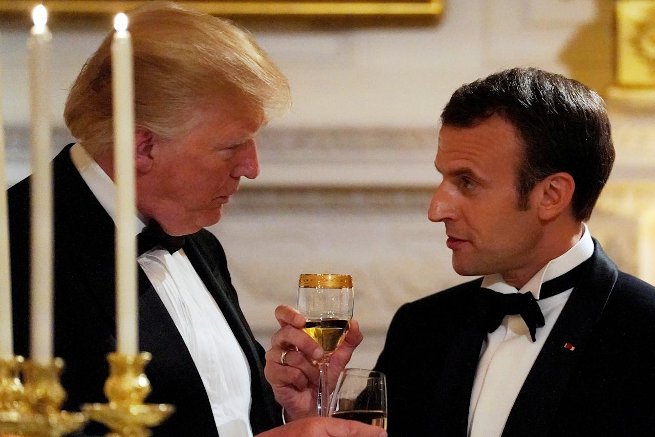 French President Emmanuel Macron toasts U.S. President Donald Trump during a State Dinner at the White House in Washington, U.S. April 24, 2018. REUTERS/Carlos Barria     TPX IMAGES OF THE DAY