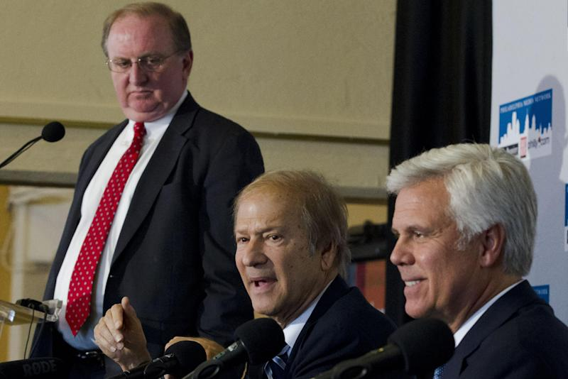 Lewis Katz, center, addresses a news conference while accompanied by William P. Hankowsky, left, and George Norcross III, Monday, April 2, 2012, in Philadelphia. The three are part of group of powerful business leaders that announced Monday that they have closed a deal to purchase Philadelphia's two largest newspapers from hedge funds for approximately $55 million, a fraction of what investors paid for them in 2006. It is the fifth time in six years the newspapers are being sold. (AP Photo/Matt Rourke)