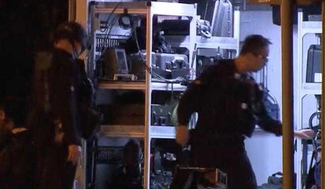 Bomb disposal officers on the scene in Wan Chai. Photo: TVB News
