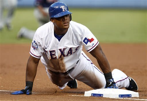 Texas Rangers' Adrian Beltre slides in safely into third on his run-scoring triple off of Minnesota Twins starting pitcher Samuel Deduno in the first inning of a baseball game Friday, Aug. 24, 2012, in Arlington, Texas. (AP Photo/Tony Gutierrez)