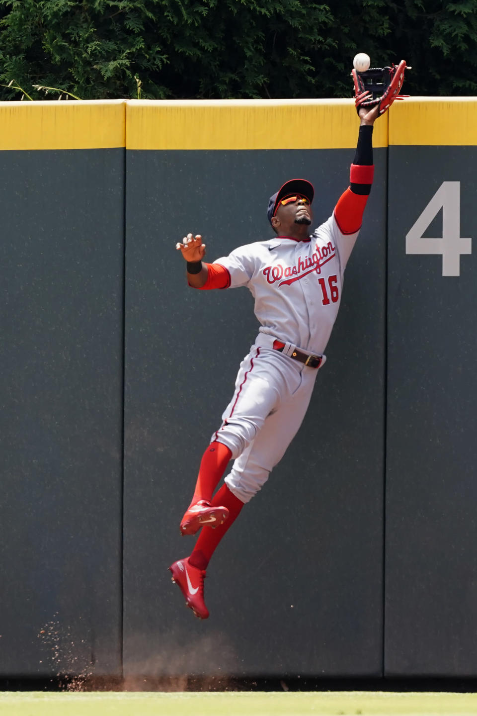 Washington Nationals center fielder Victor Robles (16) catches a ball off the bat of Atlanta Braves' Austin Riley in the second inning of a baseball game Thursday, June 3, 2021, in Atlanta. (AP Photo/John Bazemore)