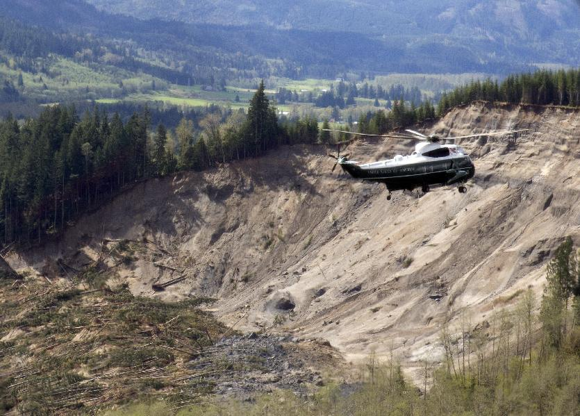 Marine One helicopter, carrying President Barack Obama, takes an aerial tour of Oso, Wash., Tuesday, April 22, 2014, above the site of the deadly mudslide that struck the community in March. (AP Photo/Carolyn Kaster)