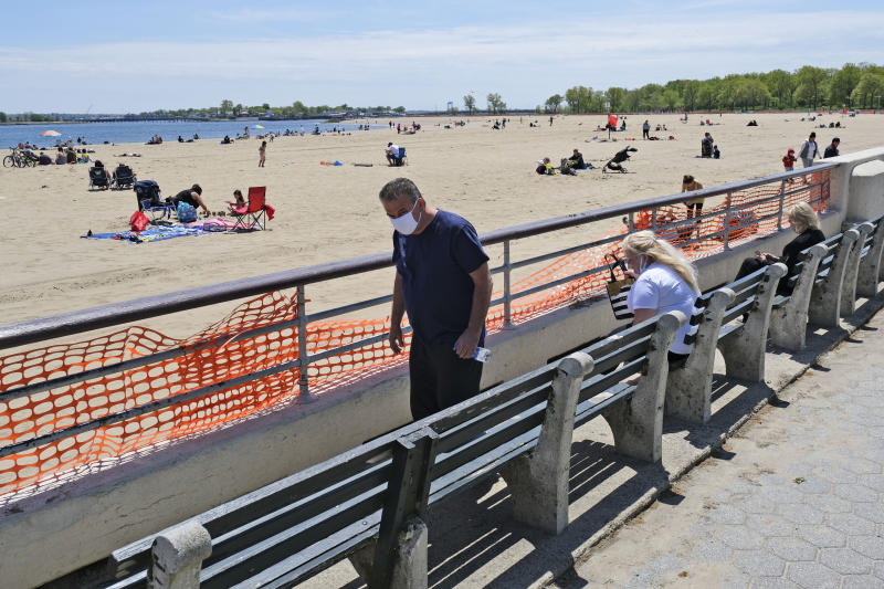 People get some fresh air at Orchard Beach in the Bronx borough of New York, Sunday, May 17, 2020. Parks, boardwalks and beaches attracted some crowds this weekend, though city beaches aren't officially open and won't be for the upcoming Memorial Day weekend. (AP Photo/Seth Wenig)