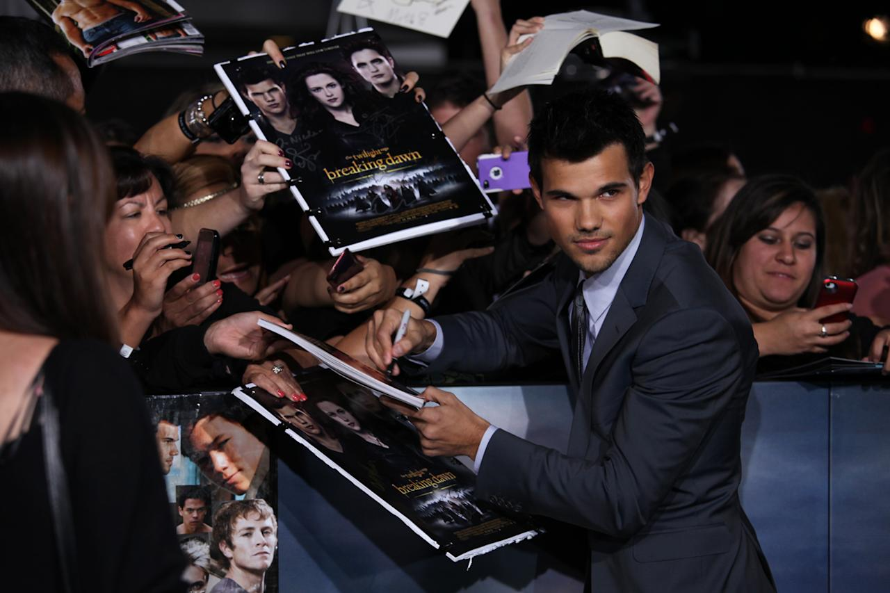 "Taylor Lautner greets fans at ""The Twilight Saga: Breaking Dawn - Part 2"" Los Angeles premiere at the Nokia Theatre L.A. Live on November 12, 2012 in Los Angeles, California."