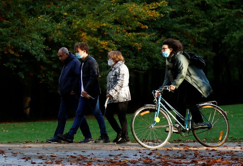 People wearing protective face masks in a park in Brussels