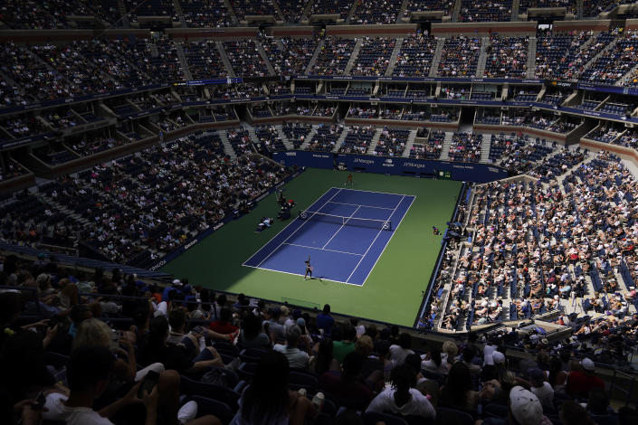 Sloane Stephens, of the United States, serves to Madison Keys, of the United States, during the first round of the US Open tennis championships, Monday, Aug. 30, 2021, in New York. (AP Photo/Seth Wenig)