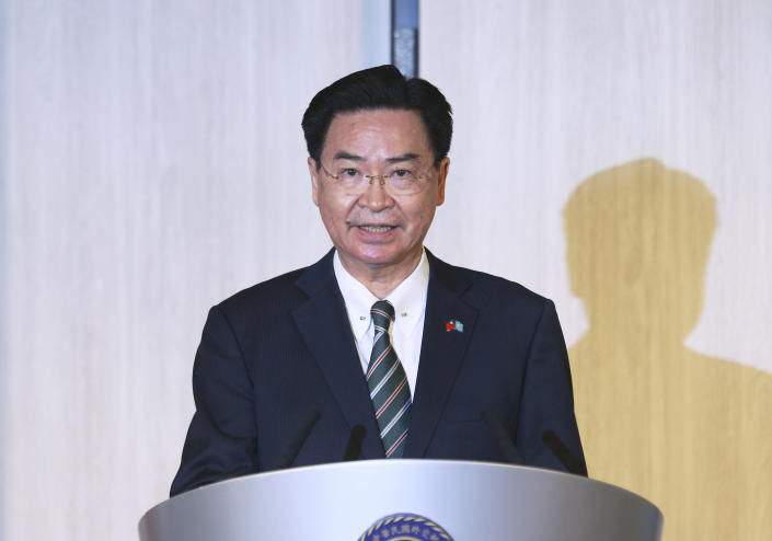 Taiwanese Foreign Minister Joseph Wu speaks at a news conference with Palau President Surangel Whipps in Taipei, Taiwan, Monday, March 29, 2021. Whipps arrived in Taiwan on Sunday, a five-day visit to kick-off a Taiwan-Palau travel bubble that starts April 1. (AP Photo/Chiang Ying-ying)