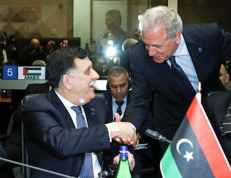 Faiez Mustafa Serraj, President of the Presidency Council of the Government of National Accord of Libya (L), shakes hands with European Commissioner for Migration and Home Affairs Dimitris Avramopoulos during a meeting in Rome, Italy March 20, 2017. REUTERS/Remo Casilli