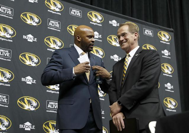 Missouri AD Jim Sterk, right, apologized on Thursday for his accusations against Dawn Staley. (AP)