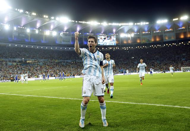In this Sunday, June 15, 2014 photo, Argentina's Lionel Messi celebrates scoring his side's second goal during the group F World Cup soccer match between Argentina and Bosnia at the Maracana Stadium in Rio de Janeiro, Brazil. After a frustrating first half, the Argentina captain scored in trademark style in the 65th minute on Sunday night, completing a quick 1-2 connection with Gonzalo Higuain and running through defenders before striking a brilliant left-footed shot off the post. (AP Photo/Victor R. Caivano)