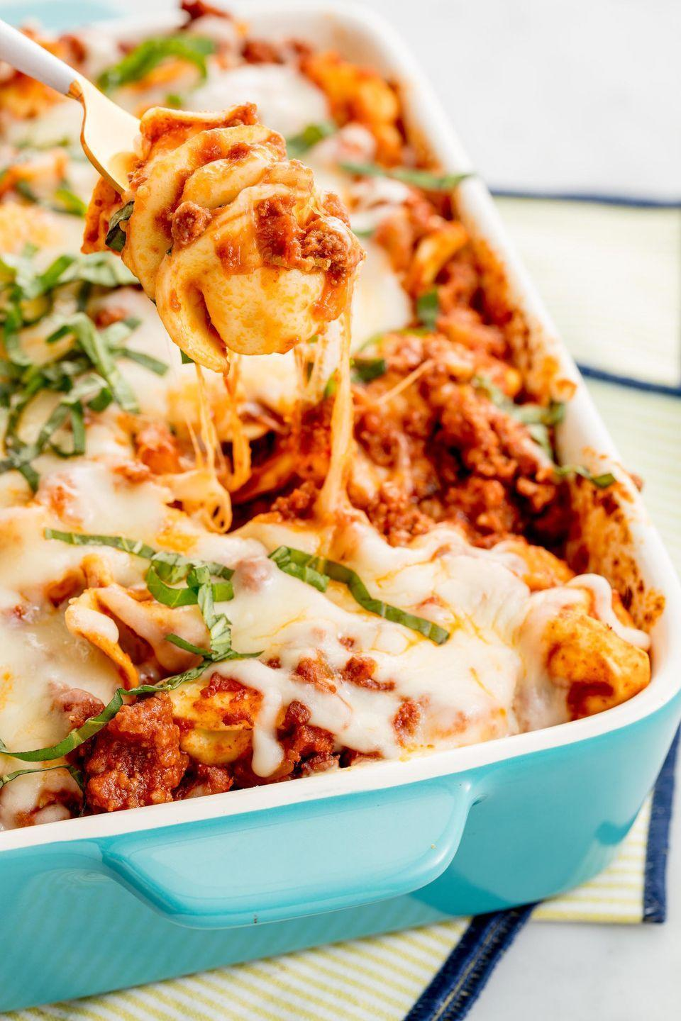 """<p>That cheese pull though 😍</p><p>Get the recipe from <a href=""""https://www.delish.com/cooking/recipe-ideas/recipes/a47130/bolognese-tortellini-bake-recipe/"""" rel=""""nofollow noopener"""" target=""""_blank"""" data-ylk=""""slk:Delish"""" class=""""link rapid-noclick-resp"""">Delish</a>.</p>"""