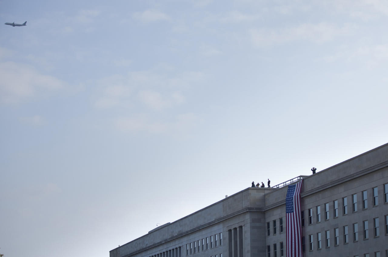Members of the Secret Service counter sniper team and other security take positions on the roof before a memorial service at the Pentagon September 11, 2011 in Arlington, Virginia.  Vice President Joseph R. Biden, Secretary of Defense Leon E. Panetta, Chairman of the Joint Chief of Staff Navy Admiral Mike Mullen and others will attend a memorial service at the Pentagon Memorial to commemorate the 10th anniversary the September 11, 2001 terrorist attacks on the United States.  (Photo by Brendan Smialowski/Getty Images)