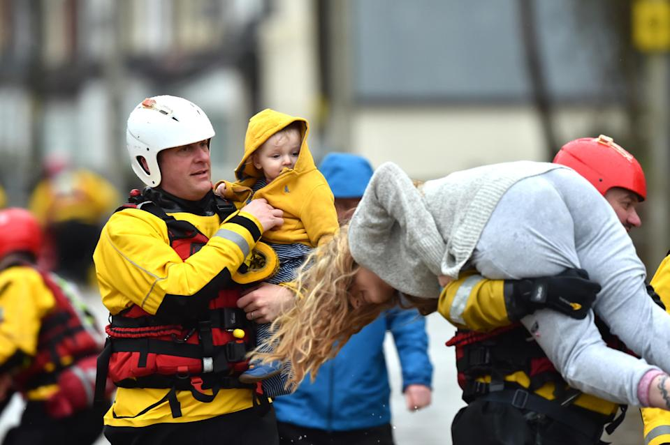 Emergency services took families to safety, after flooding in Nantgarw as Storm Dennis hit the UK in February (Ben Birchall/PA)