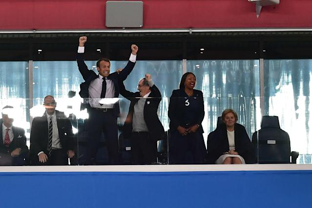 <p>French President Emmanuel Macron (C-L) celebrates, alongside French Football Federation (FFF) president Noel Le Graet (C) and French Sports Minister Laura Flessel, at the end of the Russia 2018 World Cup semi-final football match between France and Belgium at the Saint Petersburg Stadium in Saint Petersburg on July 10, 2018. – France reached the World Cup final on Tuesday after a second-half header from Samuel Umtiti gave them a 1-0 win against Belgium. (Photo by Giuseppe CACACE / AFP) </p>