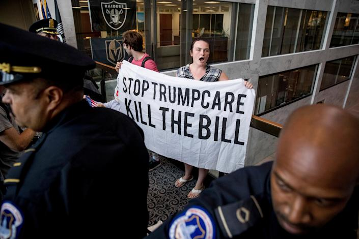Capitol Hill police prepare to arrest protesters of the Republican health care bill outside the offices of Sen. Dean Heller, R-Nev., in July 2017. (Photo: Andrew Harnik/AP)