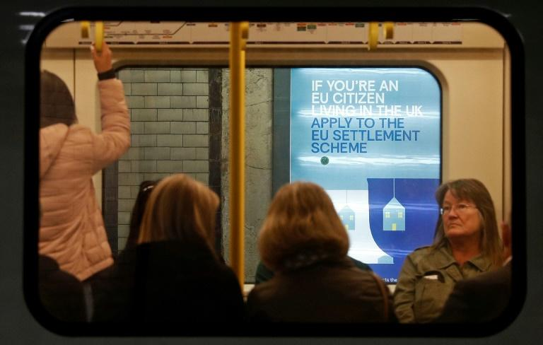 Posters aimed at helping EU citizens living in the UK have appeared in London Underground train stations