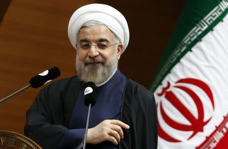 Rouhani addresses the audience during a meeting in Ankara