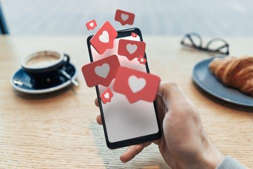 """<span class=""""caption"""">""""Sadfishing"""" is when a person posts deeply emotional, personal content online in order to get attention or sympathy. </span> <span class=""""attribution""""><a class=""""link rapid-noclick-resp"""" href=""""https://www.shutterstock.com/image-illustration/red-heart-like-symbols-on-blank-1211656696?src=5052f86a-d581-464a-a541-0f2b841d6159-1-92"""" rel=""""nofollow noopener"""" target=""""_blank"""" data-ylk=""""slk:Kostsov/Shutterstock"""">Kostsov/Shutterstock</a></span>"""