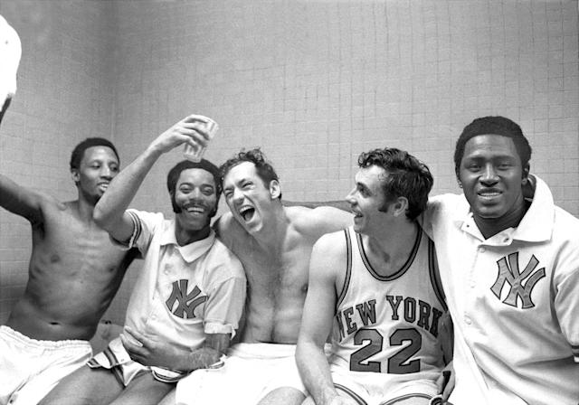 The New York Knicks' starting five — Dick Barnett, Walt Frazier, Bill Bradley, Dave DeBusschere and Willis Reed (left to right) — celebrate a playoff win. (Dan Farrell/NY Daily News Archive/Getty Images)