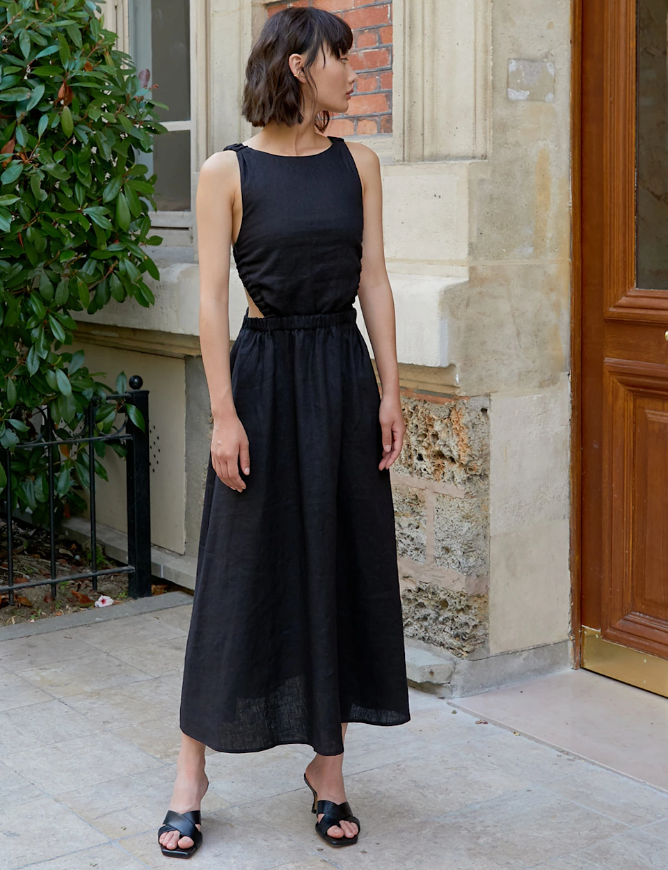 """Not pictured is the very revealing open back that makes this black linen dress an absolute ten in our books. <br> <br> <strong>Pixie Market</strong> Beatrice Black Linen Dress, $, available at <a href=""""https://go.skimresources.com/?id=30283X879131&url=https%3A%2F%2Fwww.pixiemarket.com%2Fcollections%2Fdresses%2Fproducts%2Fbeatrice-black-linen-dress"""" rel=""""nofollow noopener"""" target=""""_blank"""" data-ylk=""""slk:Pixie Market"""" class=""""link rapid-noclick-resp"""">Pixie Market</a>"""