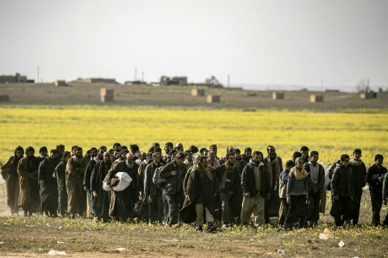 Men suspected of being Islamic State fighters surrender to Kurdish Syrian Democratic Forces in March 2019