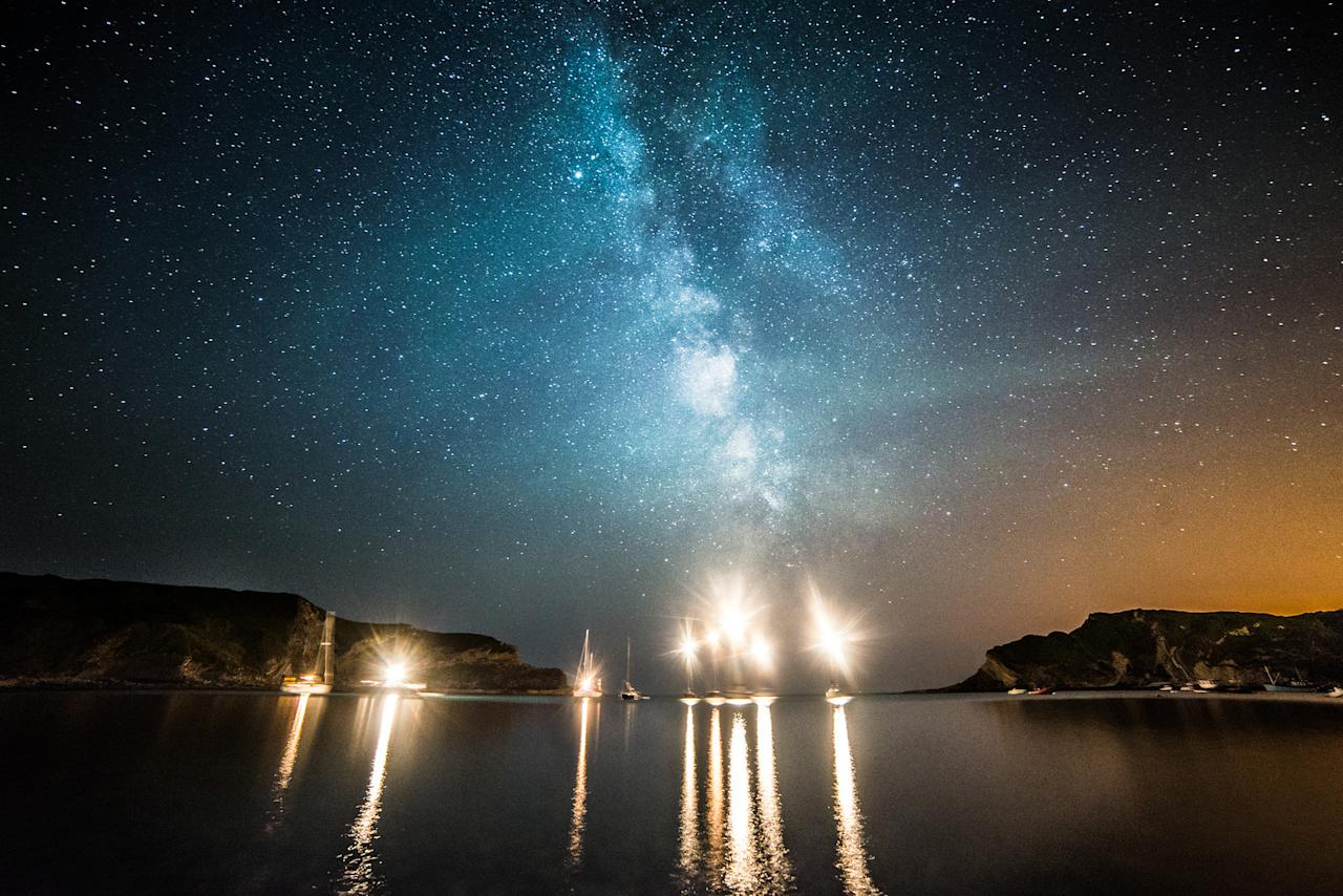 Milky Way above boats in Lulworth Cove by DorsetScouser