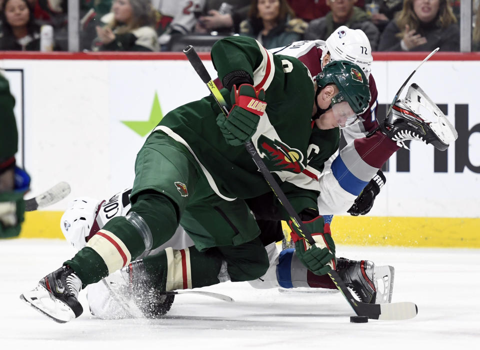 Minnesota Wild's Mikko Koivu (9), of Finland, takes control of the puck after a face-off against the Colorado Avalanche during the second period of an NHL hockey game Sunday, Feb. 9, 2020, in St. Paul, Minn. (AP Photo/Hannah Foslien)