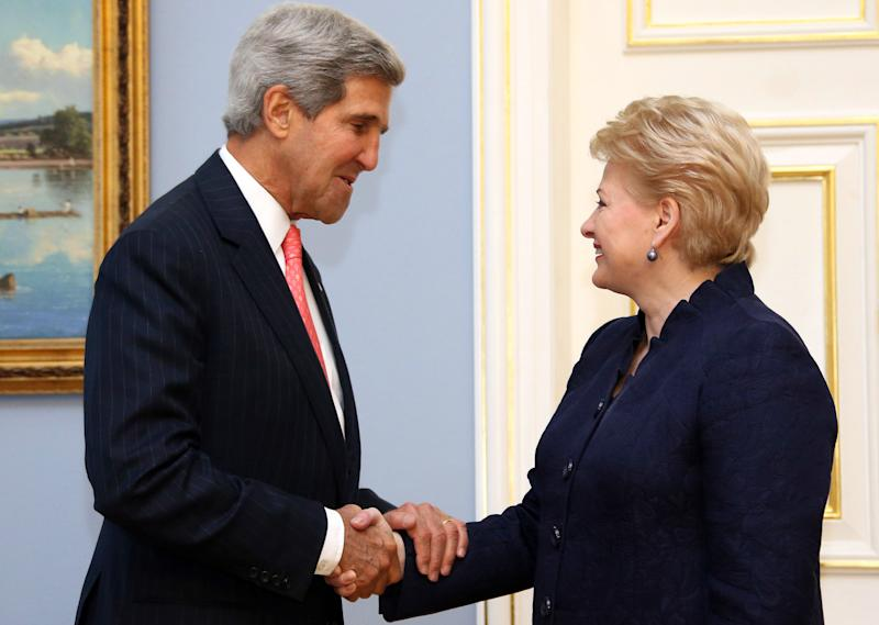 This photo made available by the Lithuanian Presidential Press Service shows United States Secretary of State John Kerry,left, and Lithuania's President Dalia Grybauskaite shaking hands prior to their meeting at the President palace in Vilnius, Lithuania, , Sept. 7, 2013. Kerry is in Europe courting international support for a possible U.S. strike on the Syrian regime for its alleged use of chemical weapons. (AP Photo/Presidential Press Service, Dzoja Borysaite)