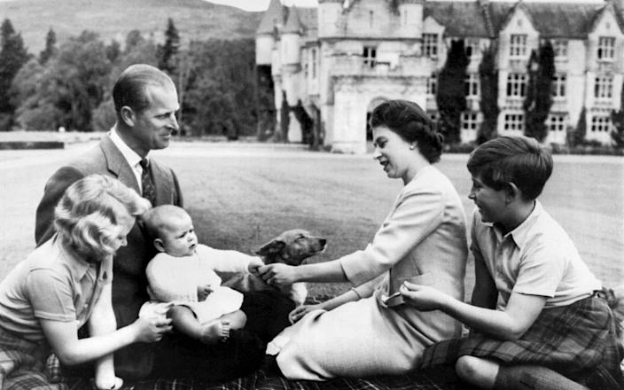 Prince Philip and the Queen with their children on the ground of Balmoral - AFP