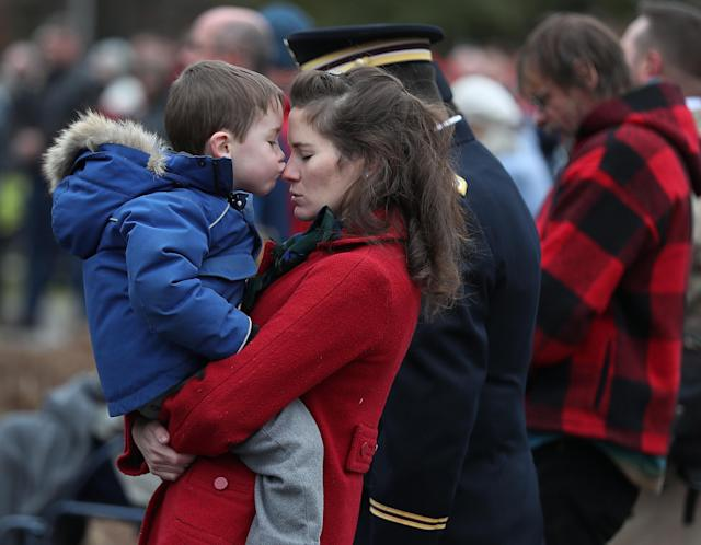 Tristan LaFlame, 4, kisses his mother, Elizabeth LaFlame, whose husband serves in the New Hampshire National Guard as they listen to the invocation during a Veterans Day ceremony at the New Hampshire State Veterans cemetery on Nov. 11, 2019 in Boscawen, New Hampshire. (Photo: Joe Raedle/Getty Images)
