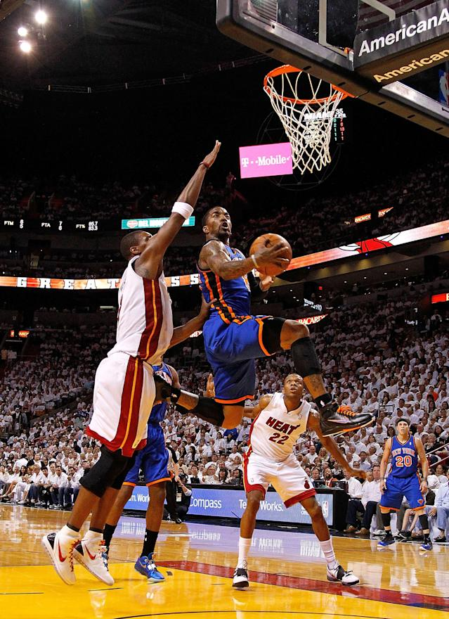MIAMI, FL - APRIL 30: J.R. Smith #8 of the New York Knicks shoots over Chris Bosh #1 of the Miami Heat during Game Two of the Eastern Conference Quarterfinals in the 2012 NBA Playoffs at American Airlines Arena on April 30, 2012 in Miami, Florida. NOTE TO USER: User expressly acknowledges and agrees that, by downloading and/or using this Photograph, User is consenting to the terms and conditions of the Getty Images License Agreement. (Photo by Mike Ehrmann/Getty Images)